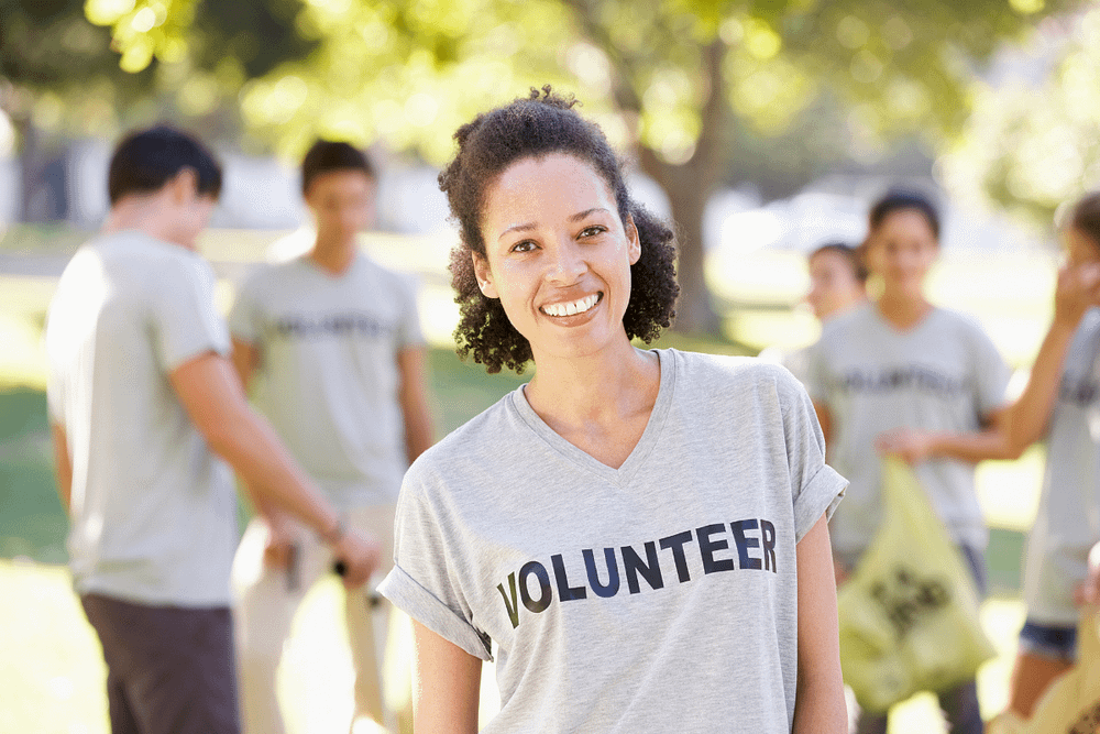 Women wearing a volunteer shirt