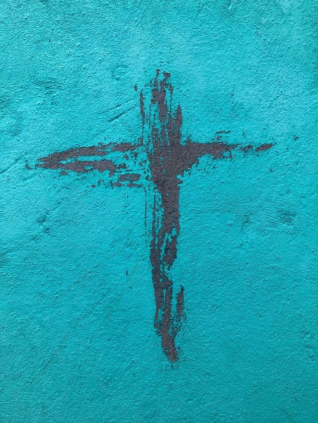 Black cross on blue background