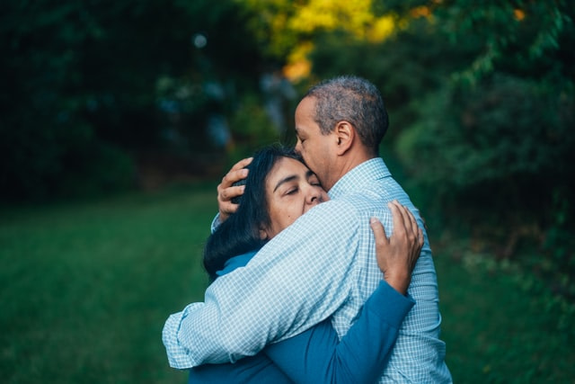 a guy and girl hugging